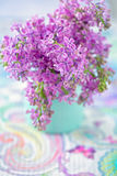 Lilacs flowers. Bouquet of lilacs flowers in a vase on the table Royalty Free Stock Photography