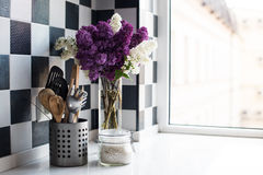 Lilacs and kitchen utensils Stock Photo