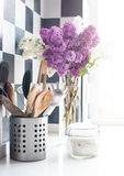 Lilacs and kitchen utensils Stock Photography