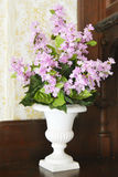 Lilacs in White Vase Stock Photography