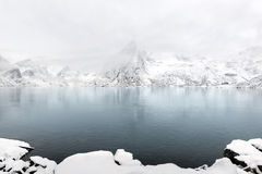 Lilandstinden mountain peak on Hamnoy island during winter time, Stock Image