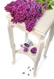 Lilas on little table Royalty Free Stock Photo