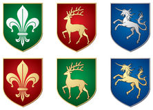 Lilie, Rotwild, Einhorn, heraldische Symbole Lizenzfreie Abbildung