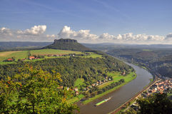 Lilienstein mesa above the river Elbe. View to the mountain Lilienstein and the river Elbe. These are part of the beautiful national park Sächsische Schweiz in Stock Image