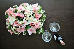 Lilies, glasses, wine royalty free stock images