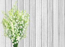 Lilies of the valley flowers on color wooden planks Stock Photos