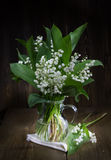 Lilies of the valley in a glass jug. Royalty Free Stock Photos