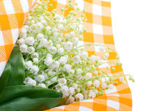 Lilies of the valley on the orange tablecloth Stock Images