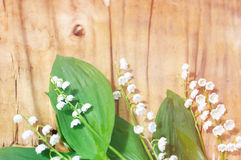 Lilies of the valley on vintage wooden background Royalty Free Stock Image