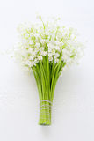 Lilies of the valley on wooden board Royalty Free Stock Images
