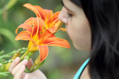 Lilium and girl Stock Image