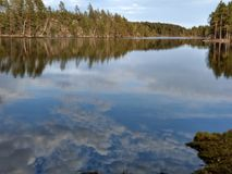 Lilla Älgsjön lake, Kolmården, Östergötland, Sweden. Lilla Algsjon lake and reflection landscape view during a spring afternoon, Ostergotland, Sweden Stock Photo