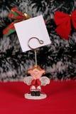 Lilla flickan har önskelistan för jul Arkivbilder