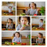 Lilla flickan i kök lagar mat grönsaksallad royaltyfri foto