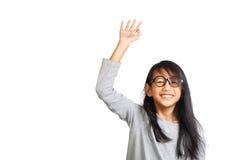 Lilla flickan lyfter upp hennes hand Royaltyfria Bilder