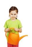 Lilla flickan med bevattna kan isolerat över vit Royaltyfri Foto