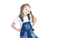 lilla overaller för blond blå flicka Arkivbilder