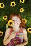 lilla solrosor för flicka Royaltyfria Bilder