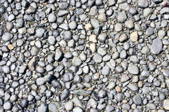 lilla stenar för strand royaltyfria foton