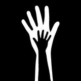 Lilla & stora händer Arkivbilder