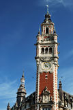 Lille, France. Tower of the Chambre de commerce and historic houses in Lille, France Stock Image