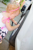 Lillte child playing in auto mechanic Stock Image
