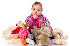 Lilltle girl with lot of toys. Lilltle girl with lot of colored toys Stock Photography