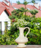Lilly of the valley flowers in white rustic vase Royalty Free Stock Photo