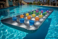 Lilo inflatable multi color pool. Multicoloured inflatable lilo fun bright water pool relaxing Stock Image