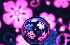 Lilor med den glass bollen för blommor Royaltyfri Foto