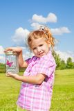 Lilttle girl holds jar with buterfly Royalty Free Stock Photo
