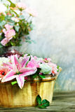Lily flower bouquet and roses decorated by arrangement in wood bucket vertical form use as  home decoration nature flora theme Stock Images