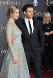 Lily James & Richard Madden. LOS ANGELES, CA - MARCH 1, 2015: Lily James & Richard Madden at the world premiere of their movie Cinderella at the El Capitan stock photography