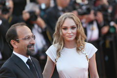 Lily-Rose Depp, Asghar Farhadi. Attend the `Ismael`s Ghosts Les Fantomes d`Ismael` screening and Opening Gala during the 70th annual Cannes Film Festival at Royalty Free Stock Photography