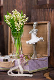 Lily on the valley and ballerina figure decor Royalty Free Stock Images