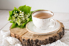 Lily of the valley and cup of tea, still life Royalty Free Stock Image