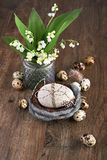 Lily of the valley and Easter decorations on old oak wood Stock Photography