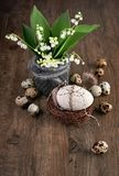 Lily of the valley and Easter decorations on old oak wood Stock Image