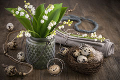 Lily of the valley and Easter decorations on old wood Stock Images