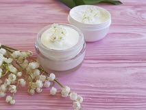 Lily of the valley flower therapy shower products cosmetic on pink wooden. Lily of the valley flower cosmetic  shower on pink wooden treatment products therapy Royalty Free Stock Photography