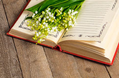 Lily of the valley flowers on the book Royalty Free Stock Photography