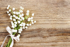 Lily of the valley flowers on wooden background. Royalty Free Stock Photography