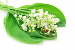 Lily of the Valley and Golden Rings Isolated. On White Background Stock Photos