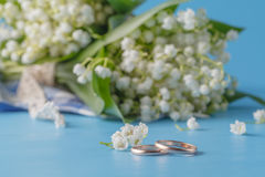 Lily of the Valley and Golden Rings. Wedding decoration. Lily of the Valley and Golden Rings Stock Photos