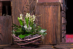 Lily on the valley in handmade basket  decor Royalty Free Stock Photo