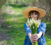 Lily of the valley in hands of beautiful girl Royalty Free Stock Images