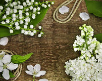 Lily of the valley, lilac and rope Stock Photos