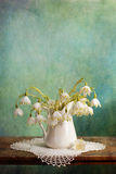 Lily of the Valley. On the painting background Stock Photo