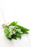 Lily of the valley posy. Isolated on white wooden background Stock Images