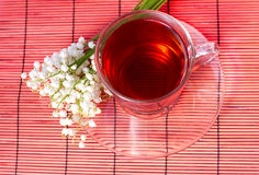 Lily of the valley and a tea Royalty Free Stock Photography